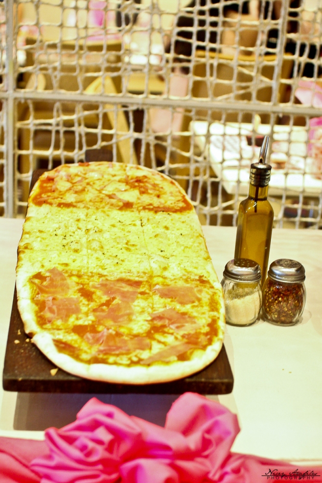 """Pizza al metro"" ... (3 flavors from top to bottom- Hawaiana , quatro formaggi, aria pizza)"